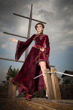 Elegant lady in vintage clothes on the peak-cap of boat Royalty Free Stock Photos