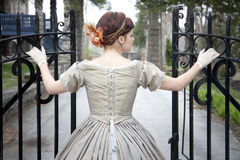 Beautiful Woman Opening Gate Royalty Free Stock Photography