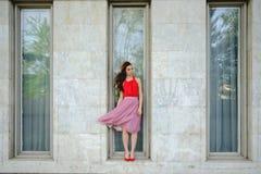 Elegant lady walking alone in the street Royalty Free Stock Photos