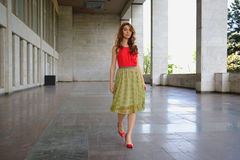 Elegant lady walking alone in the street Stock Photo