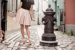 Elegant lady walking in old town Royalty Free Stock Photography