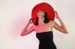 Elegant lady wearing big red hat Royalty Free Stock Photos