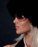Elegant lady wearing fur cap Royalty Free Stock Image