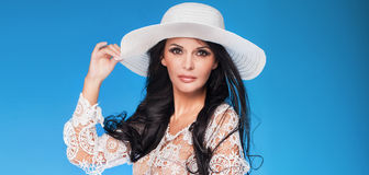 Elegant lady in white hat. Stock Photos