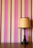 Elegant lamp. An elegant hotel lamp with a colorful wallpaper behind it Stock Photos