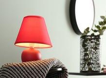 Elegant lamp on table. Near color wall Stock Photos