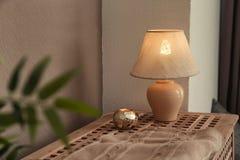 Elegant lamp on table. In room interior Stock Photo