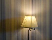 Elegant lamp with yellow light at living room Royalty Free Stock Photos