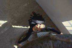Elegant latin women dancer at spin stairs. Elegant latin woman dancer at spin stairs in grunge interior style Stock Photo