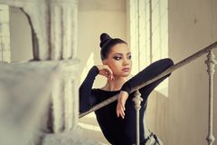 Elegant latin women dancer at spin stairs. Elegant latin woman dancer at spin stairs in grunge interior style Royalty Free Stock Images