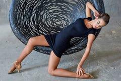 Elegant latin women dancer at hanging chair. Elegant latin woman dancer at hanging chair in grunge interior Stock Photos