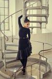 Elegant latin women dancer at spin stairs. Elegant latin woman dancer at spin stairs in grunge interior style Stock Image