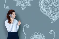 Elegant lawyer looking serious while talking on the phone stock images