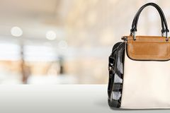 Elegant leather famale bag on blurred bright Royalty Free Stock Images