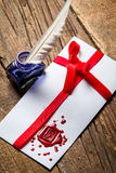 Elegant letter with red sealant and blue ink. On old woodne table royalty free stock images