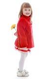 Elegant liten flicka i ett trendigt lag med a Royaltyfria Foton