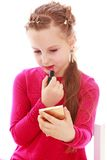 Elegant little girl paints lips with lipstick Royalty Free Stock Photos