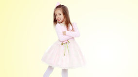 Elegant little girl in a pink dress. Stock Photo