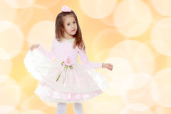 Elegant little girl in a pink dress. Stock Images