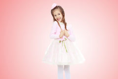Elegant little girl in a pink dress. Royalty Free Stock Photos