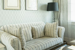 Elegant living room with striped pattern pillows on sofa Royalty Free Stock Photography