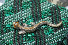 Elegant lizard - a symbol of the Mistress of Copper Mountain Stock Image