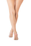 Elegant long bare female legs Stock Image