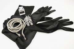Elegant long black gloves. Women black glamour gloves with accessories Stock Photography