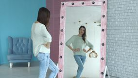 Elegant woman admiring herself reflection in mirror stock video
