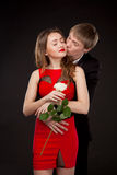 Elegant love couple wearing suit and red dress with white rose Royalty Free Stock Images