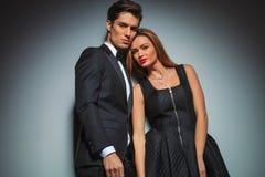 Elegant lovers posing together in studio Stock Photos