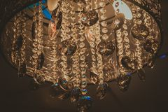 Elegant and luxurious glass decorations on the chandelier stock image