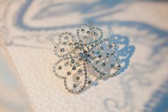 Elegant luxury bridal hair-pin on the white. Hair-pin on the white, styled with a hair ornament Royalty Free Stock Image