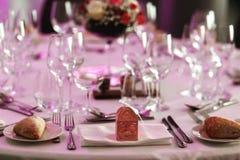 Elegant luxury cutlery and tablewear with flowers at hotel weddi Royalty Free Stock Photo