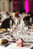 Elegant luxury cutlery and tablewear with flowers at hotel weddi Stock Photo
