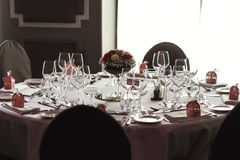 Elegant luxury cutlery and tablewear with flowers at hotel weddi Royalty Free Stock Photo