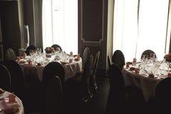 Elegant luxury cutlery and tablewear with flowers at hotel weddi Royalty Free Stock Image