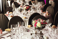 Elegant luxury cutlery and tablewear with flowers at hotel weddi Royalty Free Stock Images