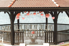 Elegant and luxury wooden wedding arbor tables chairs and decora Stock Images