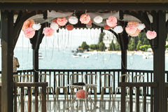 Elegant and luxury wooden wedding arbor tables chairs and decora Royalty Free Stock Images