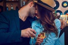 Elegant male kiss girlfriend in cheeks Royalty Free Stock Image