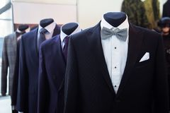 Elegant male mannequin. Presenting luxury suits tuxedo Stock Image
