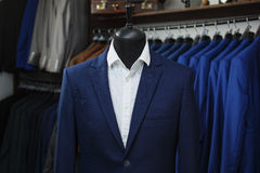 Elegant male mannequin presenting luxury suits tuxedo and male fashion accesories Stock Photo