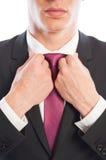Elegant male model fixing his white shirt collar Stock Photos