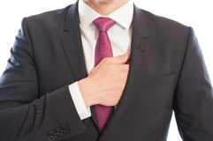 Elegant male model reaching his interior suit pocket Stock Photos