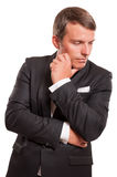 Elegant male model wearing a black suit Royalty Free Stock Images