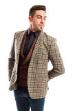 Elegant male model wearing checkered suit jacket Stock Photo