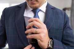 Elegant male placing smartphone in pocket. Elegant male placing expensive smartphone in suit jacket pocket as luxury concept Stock Photos