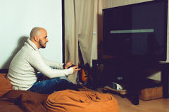 Elegant male playing computer games on tv Stock Image