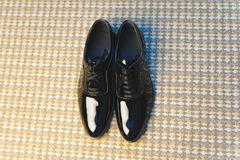 Elegant Male Shoes. Elegant male black shoes on carpet Royalty Free Stock Images